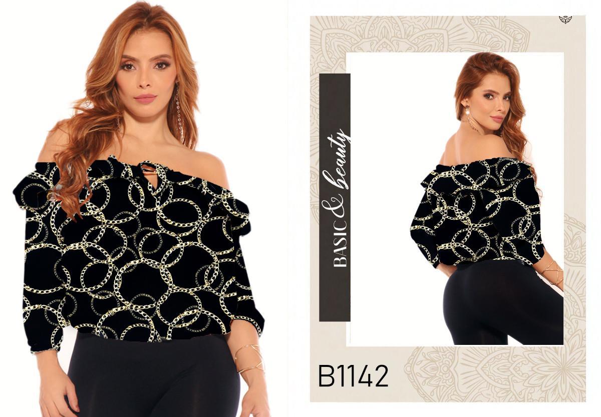 Blusa Colombiana Estilo de Moda con Mangas A medio antebrazo  y hombros descubiertos.